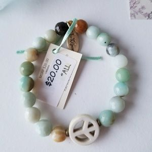 NWT Stone bead and peace bracelet. Green stretch